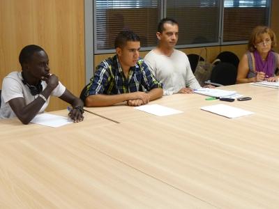 Dos usuaris de l'entitat participant a les jornades sobre exclusió i ocupació.